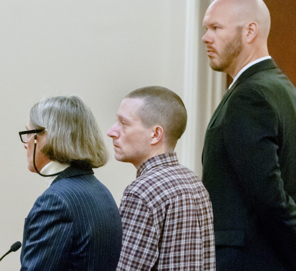 Scott A. Bubar, center, is flanked by attorneys Lisa Whittier and Scott Hess during his bail hearing Nov. 1, 2017, at the Capital Judicial Center in Augusta.