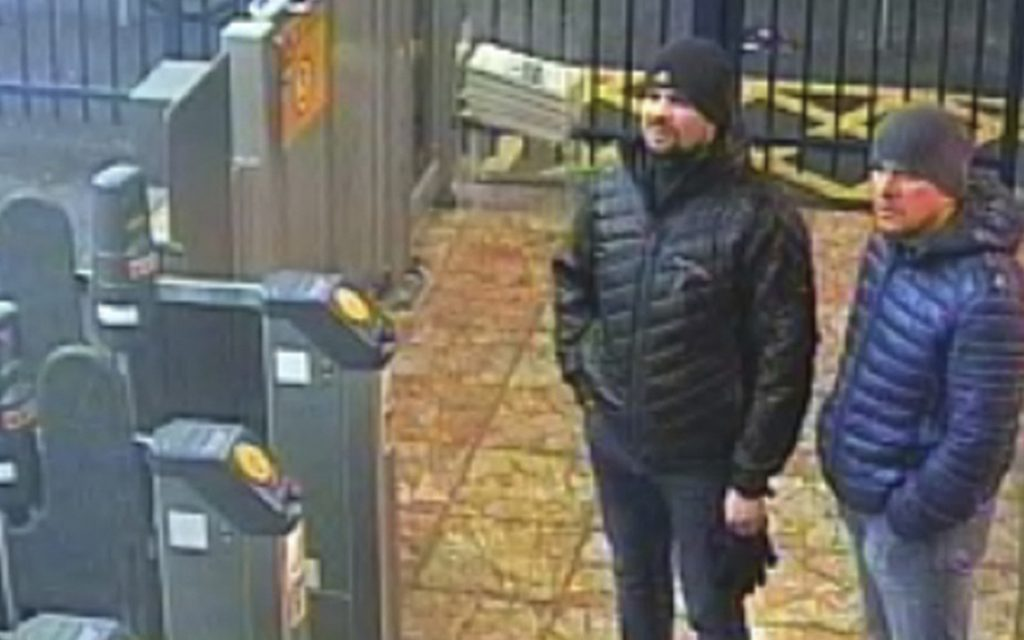 Image issued by London police Wednesday shows Russlans Ruslan Boshirov and Alexander Petrov at the Salisbury train station on March 3. British prosecutors have charged them with the nerve agent poisoning of ex-spy Sergei Skripal.