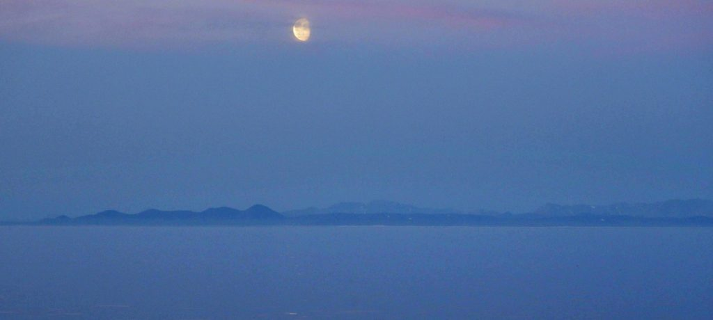 The moon rises over the coast of Alaska as a ship makes its way along the International Date Line through the Bering Strait last year. Russia and China are hoping that the Bering Strait can become an alternative to the Suez Canal.