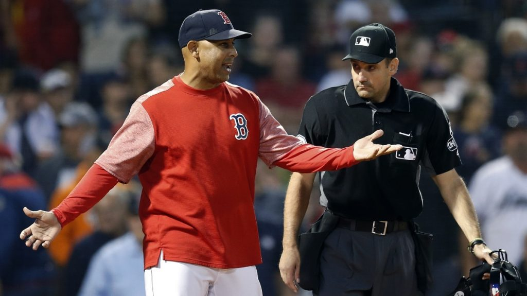 Boston Red Sox Manager Alex Cora, left, talks with plate umpire David Rackley after Ian Kinsler was called out on strikes Saturday in the eighth inning of the 5-3 loss to the Houston Astros at Fenway Park.