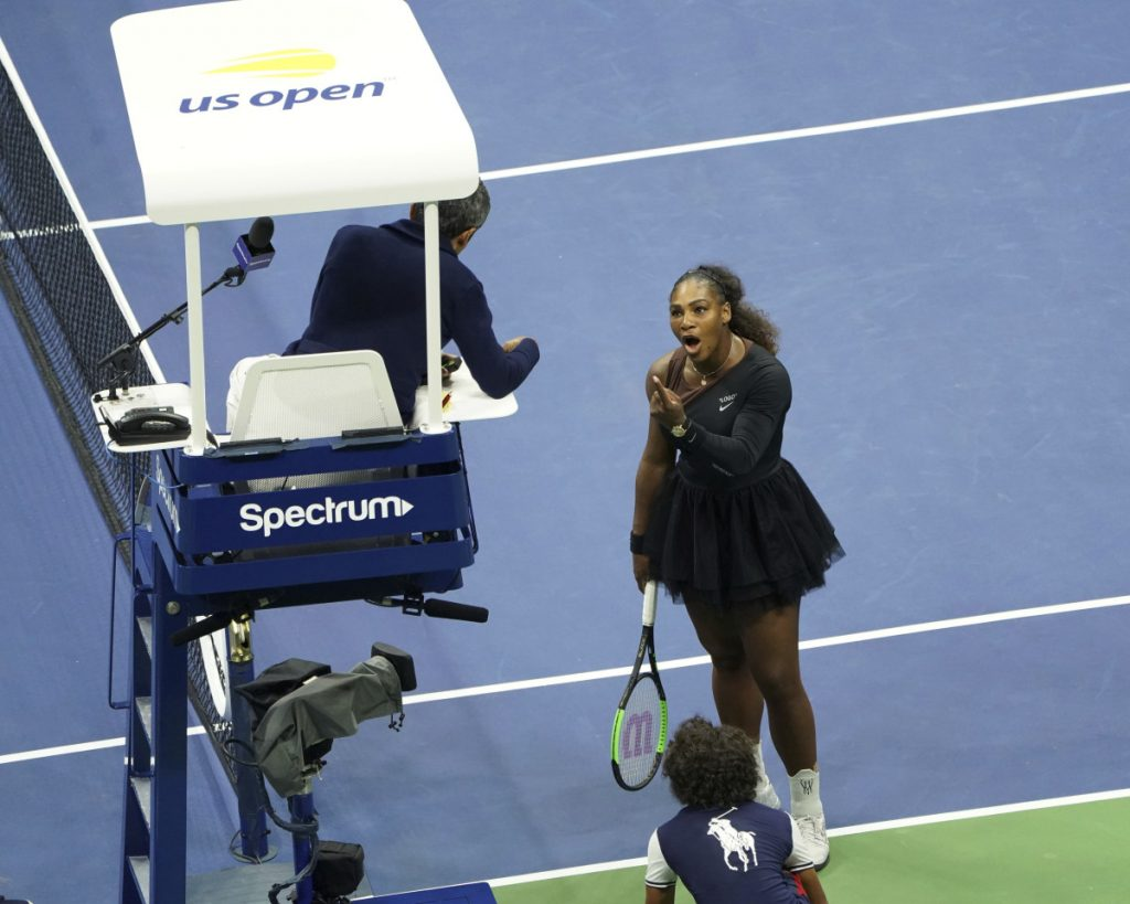 Serena Williams argues with the chair umpire during the women's final at the U.S. Open against Naomi Osaka on Saturday night in New York.