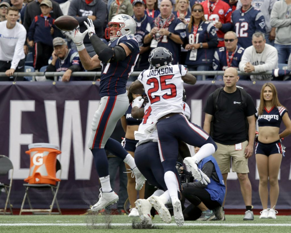 New England Patriots tight end Rob Gronkowski catches a pass in front of Houston Texans defensive back Kareem Jackson during the season opener Sunday in Foxborough, Massachusetts. Gronkowski scored the first touchdown of the game and the Patriots held on to win, 27-20.
