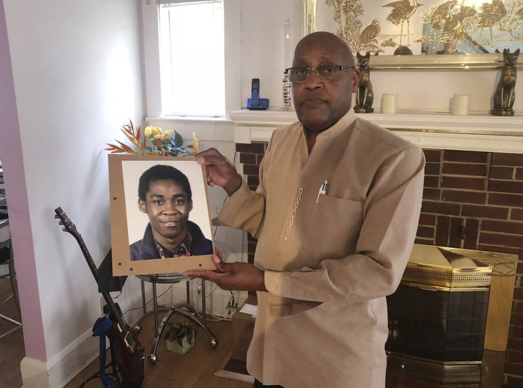 Dia Khafra, father of Askia Khafra, holds a photo of his son in his Silver Springs, Md., home. Askia Khafra died last year when a fire broke out at the Bethesda, Md., home where he and a millionaire day trader were digging tunnels for a nuclear bunker.