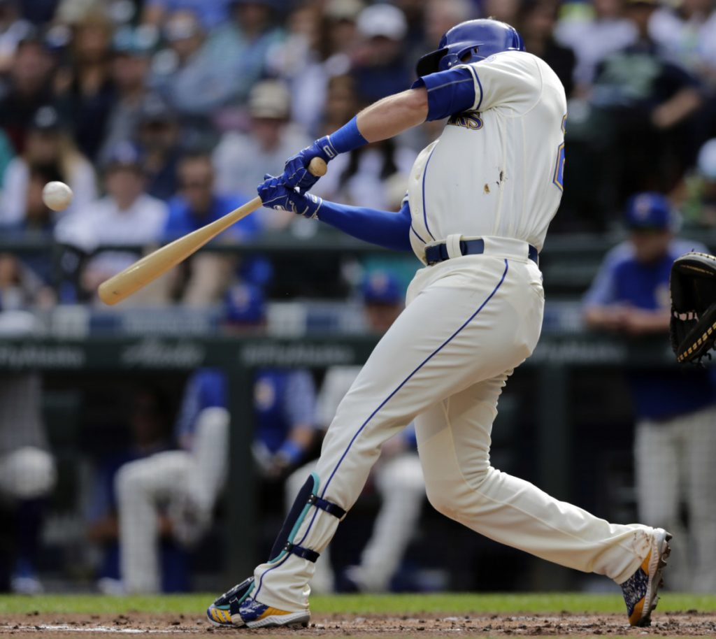 Ryon Healy of the Seattle Mariners delivers a run-scoring single Sunday during the first inning of a 3-2 victory against the New York Yankees.