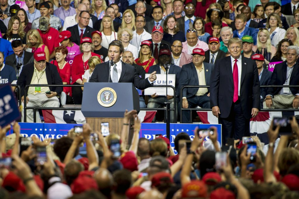 Rep. Ron DeSantis, R-Fla., is joined by President Trump at a campaign rally in Tampa, Fla., on July 31. DeSantis later won Florida's Republican primary for governor.