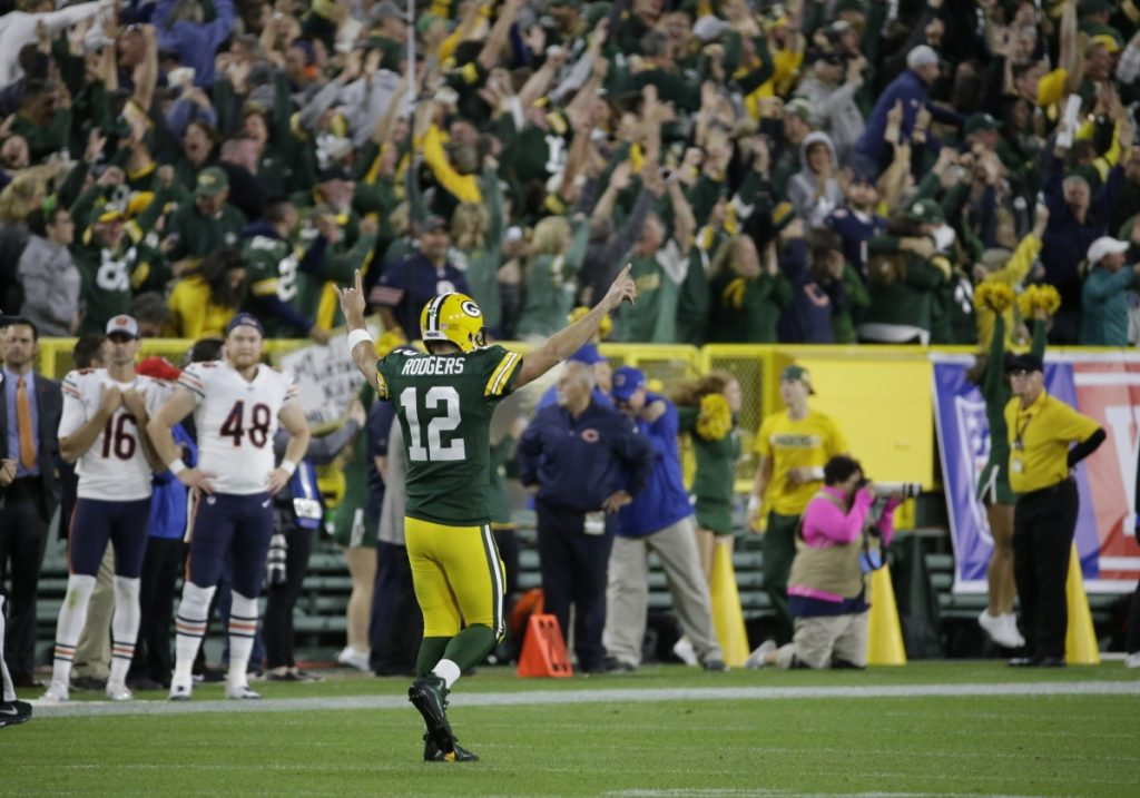 Green Bay quarterback Aaron Rodgers reacts after throwing a 75-yard touchdown pass to Randall Cobb during the second half against the Chicago Bears on Sunday night in Green Bay, Wis.