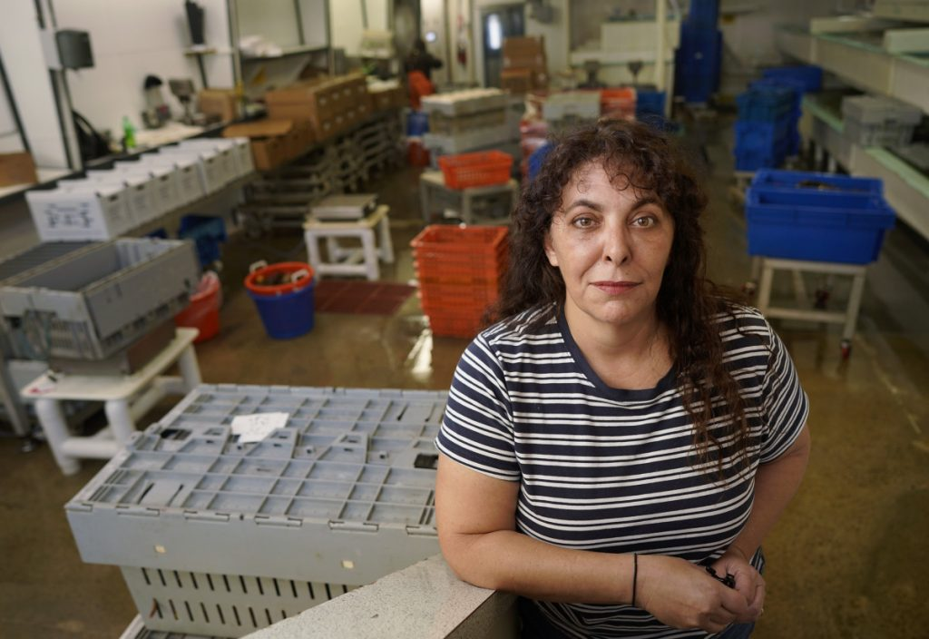 The trade war with China has forced some Maine lobster dealers like Stephanie Nadeau, owner of The Lobster Co. in Arundel, to lay off workers.