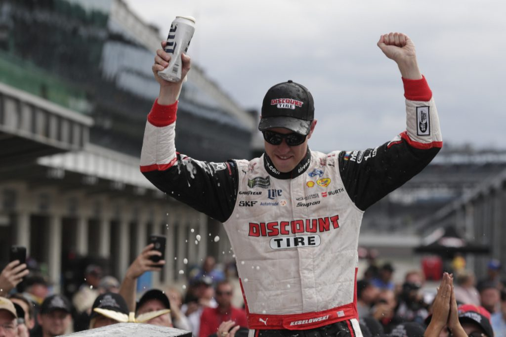 Brad Keselowski celebrates after capturing the Brickyard 400 on Monday, giving team owner Roger Penske a single-season sweep at Indianapolis Motor Speedway. Will Power won the Indy 500 for Penske in May.