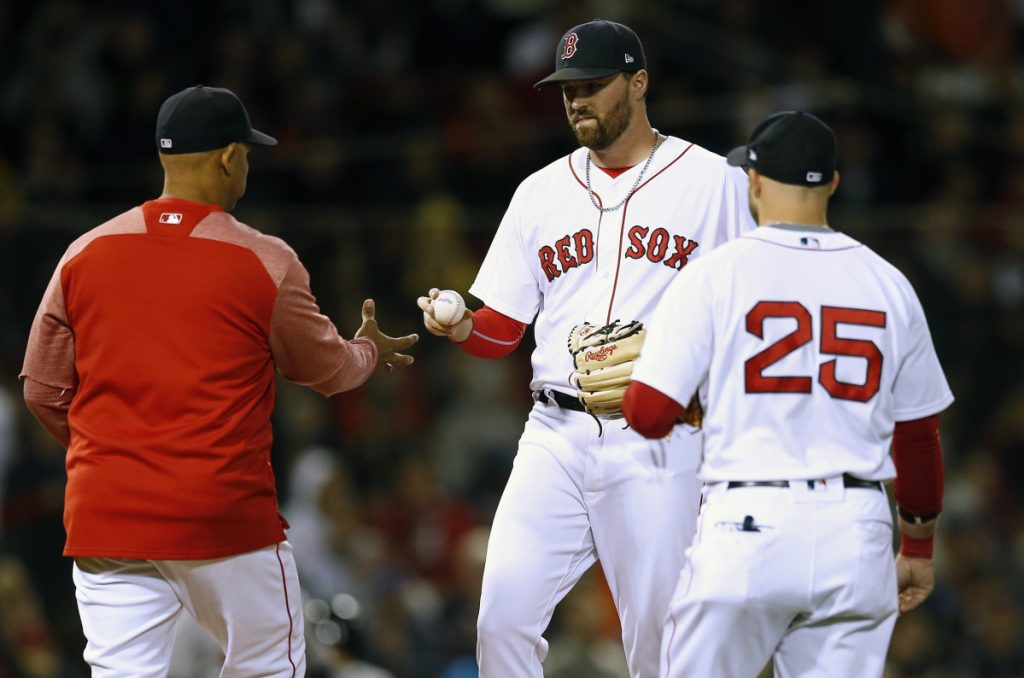 Boston Red Sox Manager Alex Cora, left, taking out Heath Hembree on Sunday night, has intriguing options for the bullpen in the playoffs. Like, say, Eduardo Rodriguez. Or Nathan Eovaldi. Or maybe an inning or two of the baffling Steven Wright.