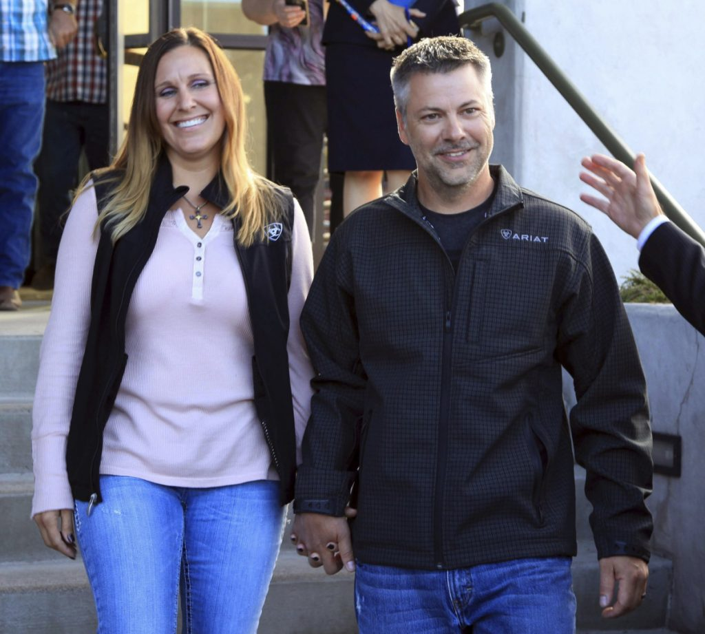 This photo provided by the Oregon Justice Resource Center shows Josh Horner with his wife Kelli Horner after a hearing in Bend, Ore., Monday, Sept. 10, 2018. A 50-year sentence in a sex abuse case against Horner was dismissed Monday by Deschutes County District Attorney John Hummel after the Oregon Innocence Project found holes in the 2017 conviction that undermined the credibility of the complainant, including that Horner had shot the dog in front of her. (Jenny Coleman/Oregon Justice Resource Center via AP)