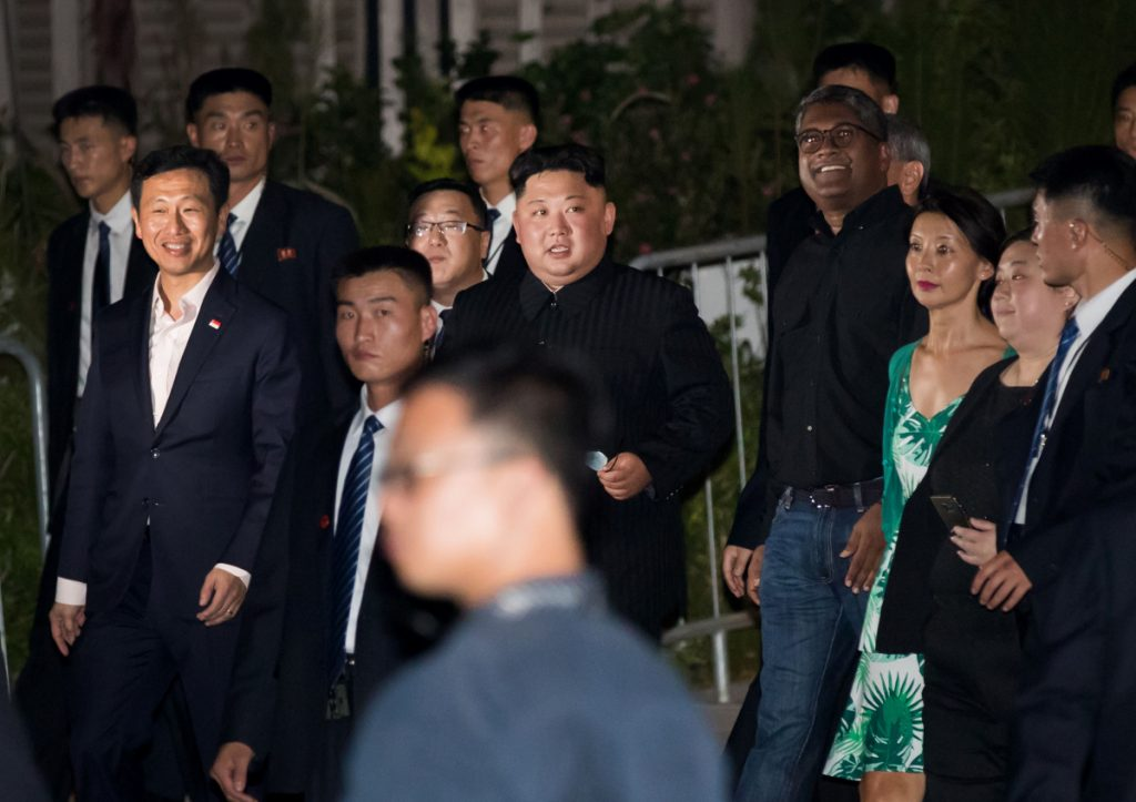 North Korean leader Kim Jong Un, center, tours the Esplanade in Singapore on June 11. Talks have begun for a follow-up meeting between Kim and President Trump.