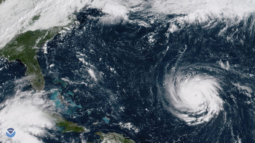 This satellite image provided by NOAA shows Hurricane Florence as it threatens the U.S. East Coast. As mandatory evacuations begin for parts of several East Coast states, millions of Americans have been preparing for what could become one of the most catastrophic hurricanes to hit the Eastern Seaboard in decades.