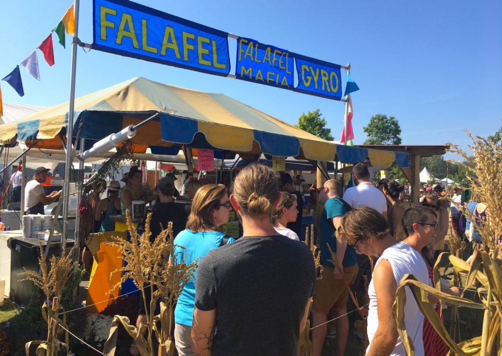 Falafel Mafia attracts a line at midday at the Unity fair. The longtime Common Ground Fair vendor is now known for its all-vegan food truck that sets up in and around Portland.
