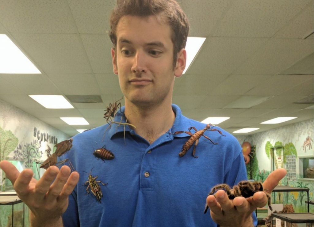John Cambridge, owner and chief executive of the Philadelphia Insectarium and Butterfly Pavilion, with some of the museum's residents before the heist. At left, a red-knee tarantula, one of the species stolen last month. Cambridge said he suspects it was an inside job and the thieves made off with an estimated $30,000 to $50,000 worth of insects. Philadelphia Insectarium and Butterfly Pavilion
