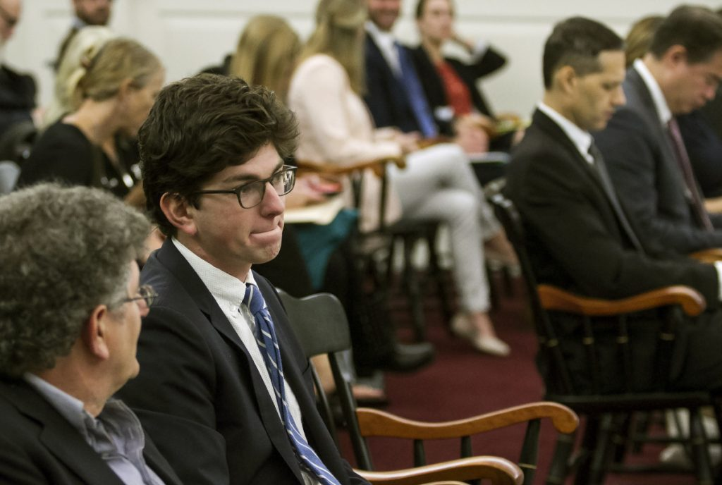 Owen Labrie, second from left, sits with his father before arguments are made before the New Hampshire Supreme Court on Labrie's request for a new trial Thursday.