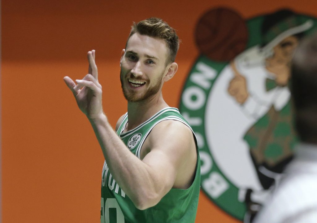 Boston's Gordon Hayward waves as he steps off the basketball court after speaking with members of the media and taking part in a photo shoot on Thursday. Hayward is working his way back from a broken leg.