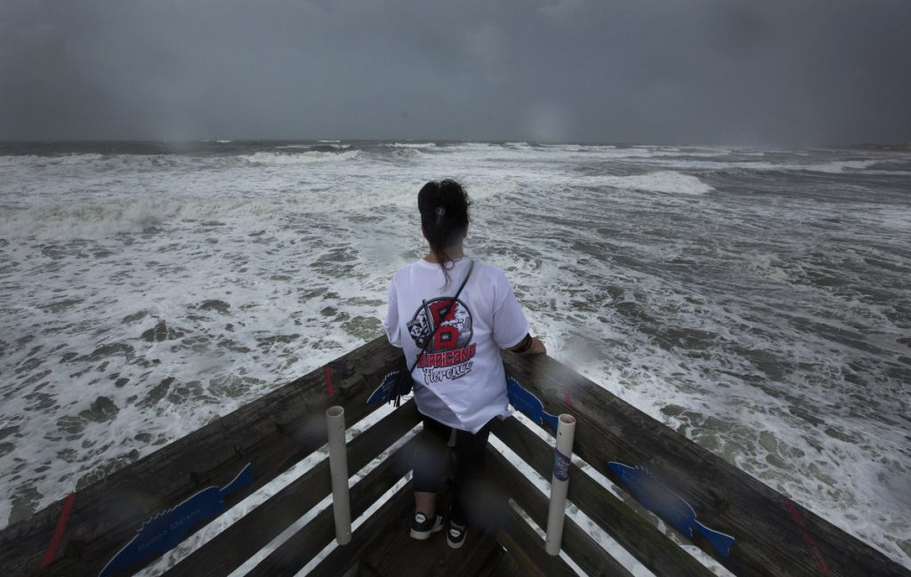 Kimberly Lancaster takes in the view from Avalon Fishing Pier in Kill Devil Hills, N.C., on Thursday. The storm surge is expected to be 7 to 11 feet above sea level.