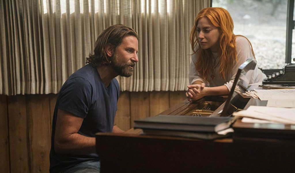 "Bradley Cooper and Lady Gaga as Jackson Maine and Ally in ""A Star Is Born."" Cooper also directs the film, the fourth big-screen production of the story. Previous versions starred Janet Gaynor, Judy Garland and Barbra Streisand."
