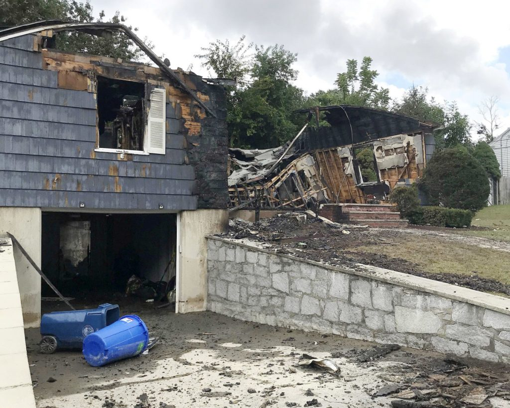The house owned by police officer Ivan Soto sits nearly burned to the ground in Lawrence, Mass., on Friday. After rushing home to check on his family and warn his neighbors to evacuate as explosions set off fires in 60 to 80 homes in the Lawrence area Thursday, Soto went back on patrol while his house was burning.