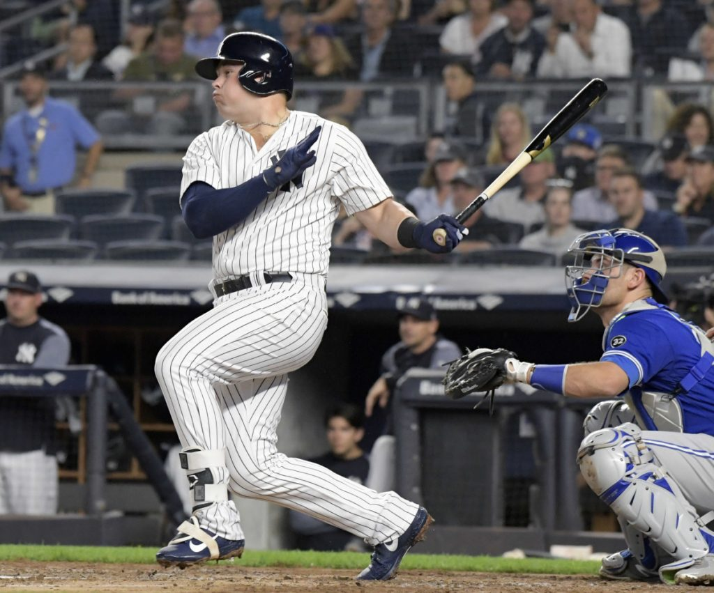 New York's Luke Voit hits a two-run double in the first inning Friday night when the Yankees scored five runs on the way to an 11-0 win over the Blue Jays in New York.