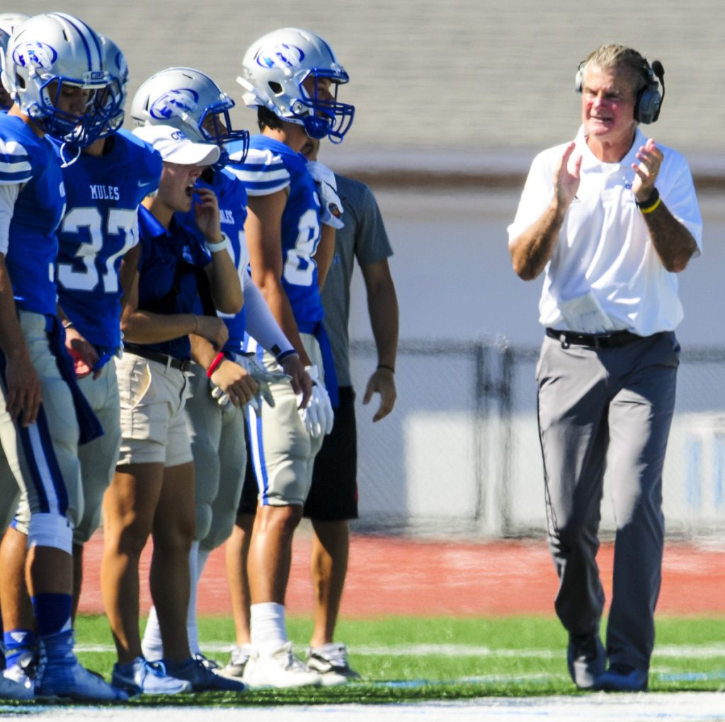 Jack Cosgrove is back on the sideline, exhorting his team. But now it's Colby College, not UMaine, and there's plenty to get done after a 35-0 loss to Trinity in its opener.