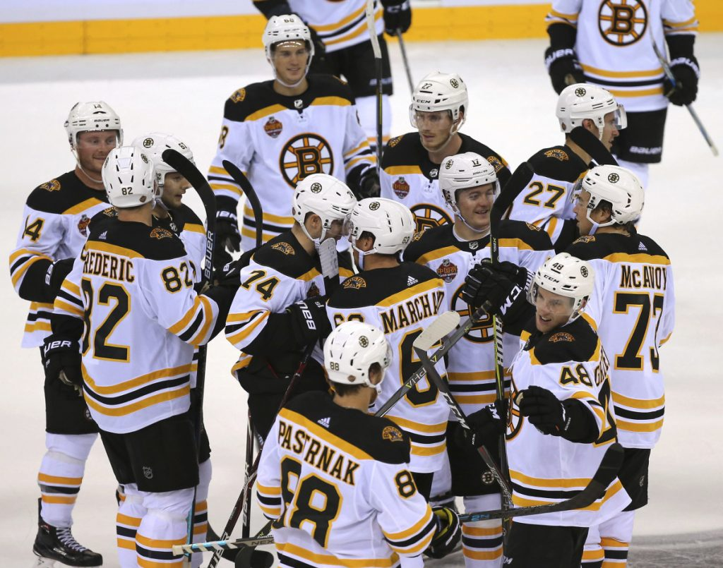 Members of the Boston Bruins celebrate after beating Calgary in the 2018 NHL China Games in Shenzhen, Southern China's Guangdong province on Saturday.