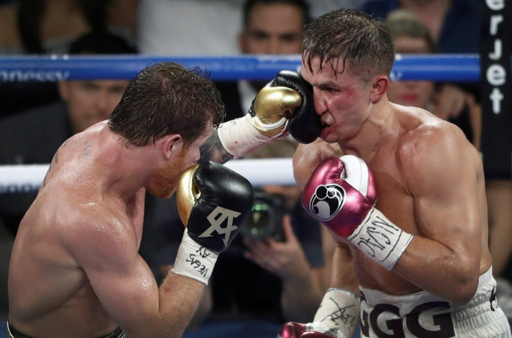 Canelo Alvarez, left, lands a punch on WBC/WBA middleweight champion Gennady Golovkin during their title fight in Las Vegas late Saturday night. Alvarez took Glolovkin's WBC/WBA titles by majority decision.