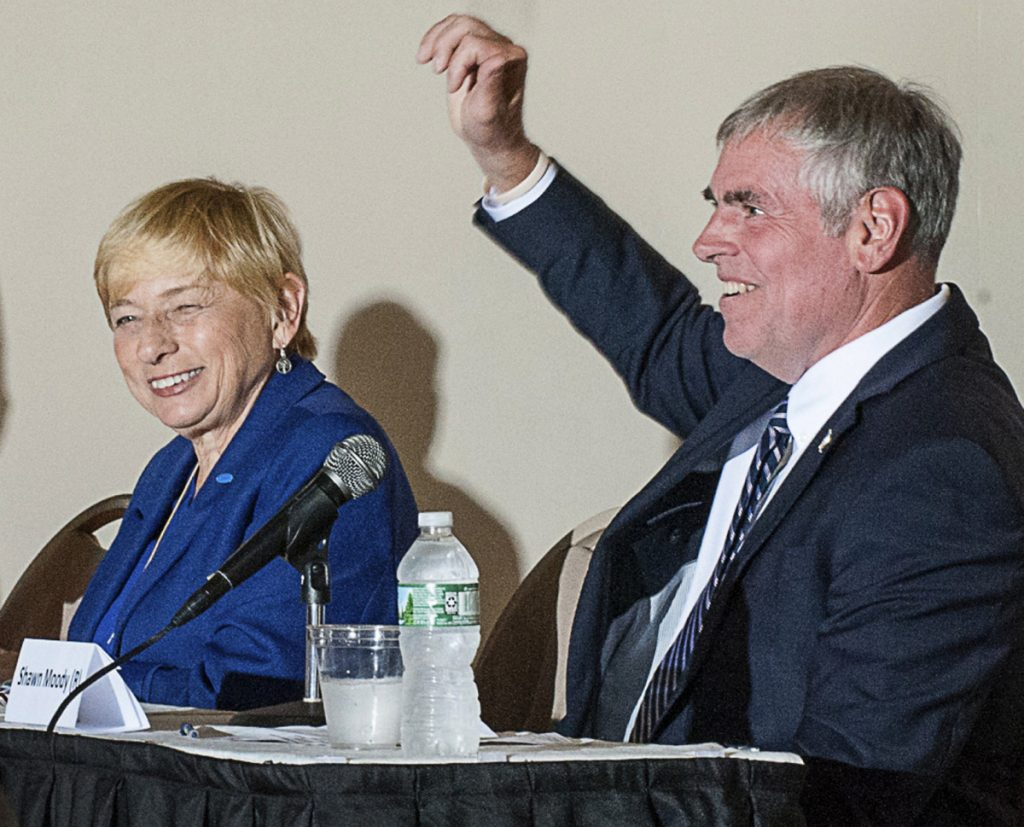 Janet Mills and Shawn Moody attend a forum with other gubernatorial candidates in Lewiston on Sept. 10.