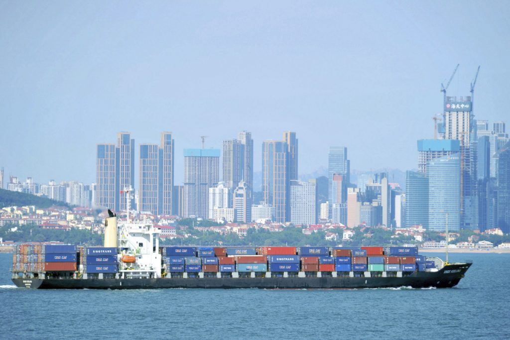 A container ship sails past the city skyline of Qingdao in eastern China's Shandong province. The Trump administration announced Mondaythat it will impose tariffs on $200 billion more in Chinese goods starting next week, escalating a trade war between the world's two biggest economies. China responded Tuesday by raising tariffs on $60 billion more American-made products.