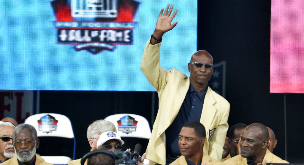 Former running back Eric Dickerson, during his Pro Football Hall of Fame enshrinement Aug. 2, 2014, is among a group of Hall of Famers demanding health insurance coverage and a share of NFL revenues.