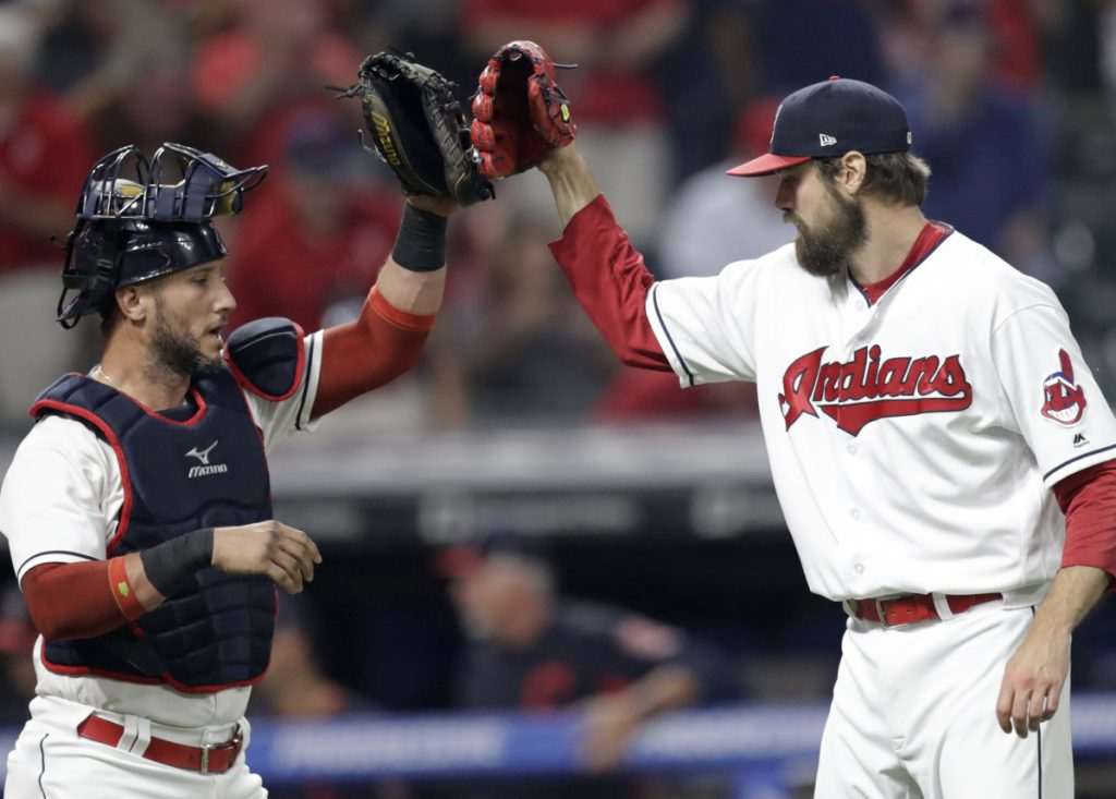Indians reliever Andrew Miller, right, is congratulated by catcher Yan Gomes after the team's 5-3 victory over the White Sox on Tuesday in Cleveland.