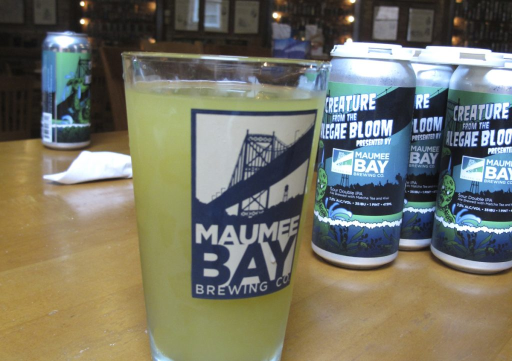 "Maumee Bay Brewing makes Alegae Bloom beer to draw attention to the toxic algae on Lake Erie. ""We're going to keep doing this until the algae bloom isn't there anymore,"" brewery manager Craig Kerr said."