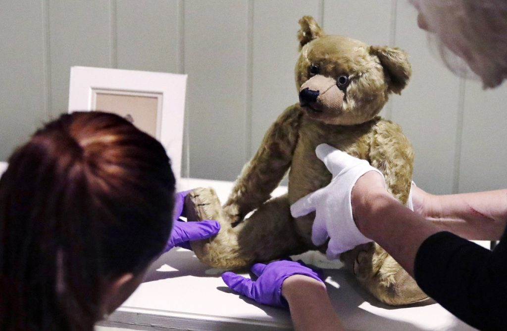 An antique bear is positioned for a show that will open Saturday at the Museum of Fine Arts in Boston.