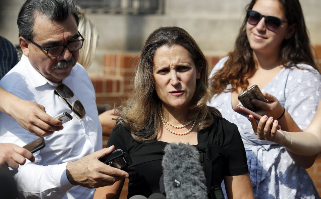 Canadian Foreign Affairs Minister Chrystia Freeland, center, speaks to the media as she arrives at the Office of the United States Trade Representative on Sept. 19.