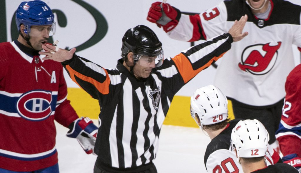 NHL referee Wes McCauley, seen here in action during a preseason game between the Canadians and Devils on Monday, is well known for his animated calls, but also for making the right call more often than not.
