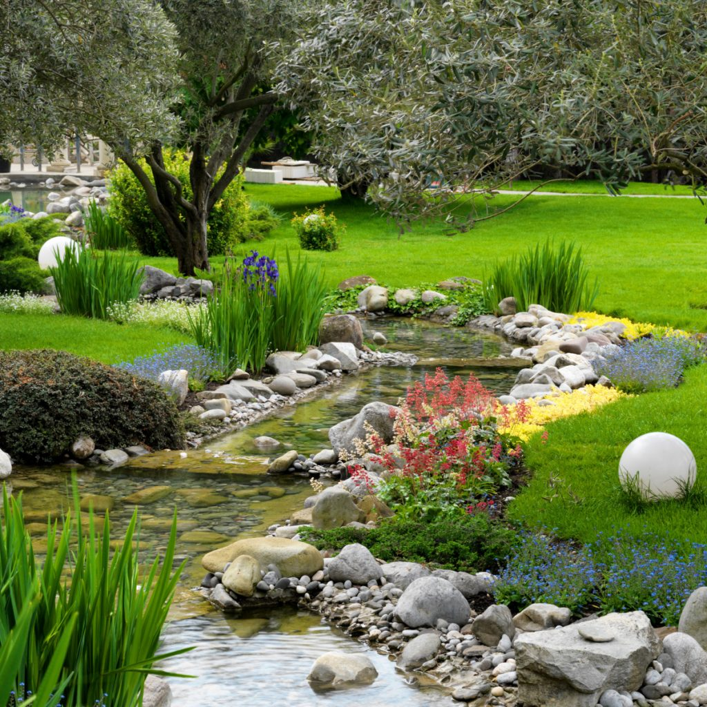 Part Of This Large Japanese Garden Contains A Pond, Above. Using Rocks And  Native