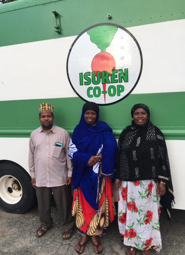 Isaack Gawo, Ghali Farrah and Isnino Ibrahim in front of the Isuken Co-op food truck.