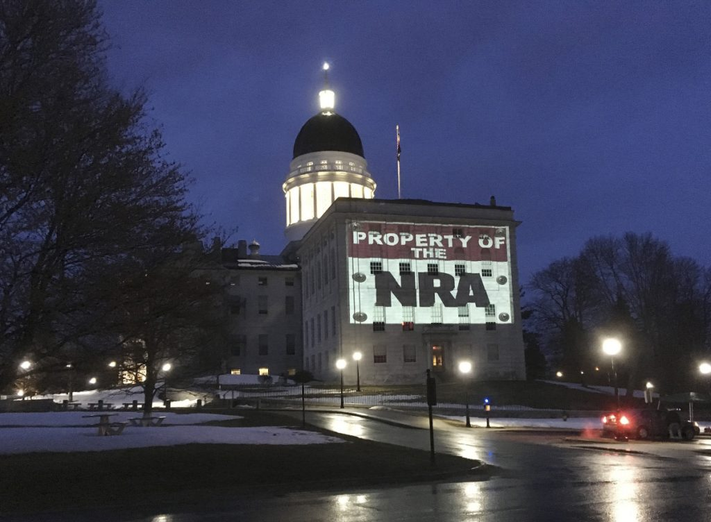 In March, LumenARRT! – part of the Artists Rapid Response Team – projected protest messages on the State House. The Legislative Council voted 6-0 Thursday to prohibit such political displays.
