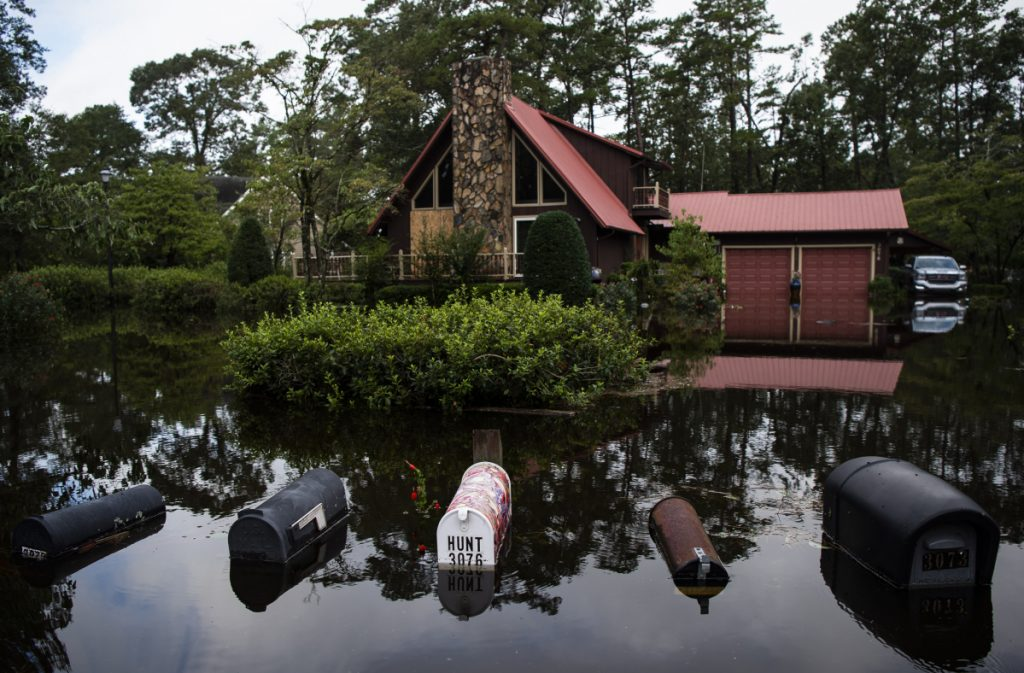 Homes are surrounded by floodwaters in Lumberton, N.C., in the aftermath of Hurricane Florence on Monday. At least 42 people have died in a disaster that seems like it won't end.