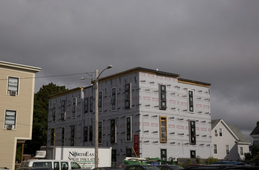 The Onejoy project, a 12-unit condo building under construction in Portland's West End. A unit in the development is being set aside as affordable housing for a middle-income family.
