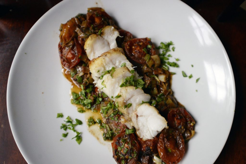 Seared Monkfish with Charred Tomato, Leek and Vermouth Sauce.