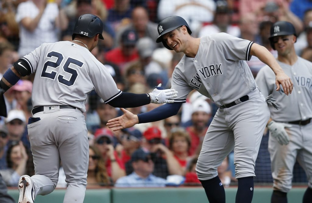 Gleyber Torres, is greeted at home plate by Greg Bird after hitting a two-run home run, the record-setting 265th of the season for the Yankees, during their 8-5 win over the Red Sox on Saturday in Boston.