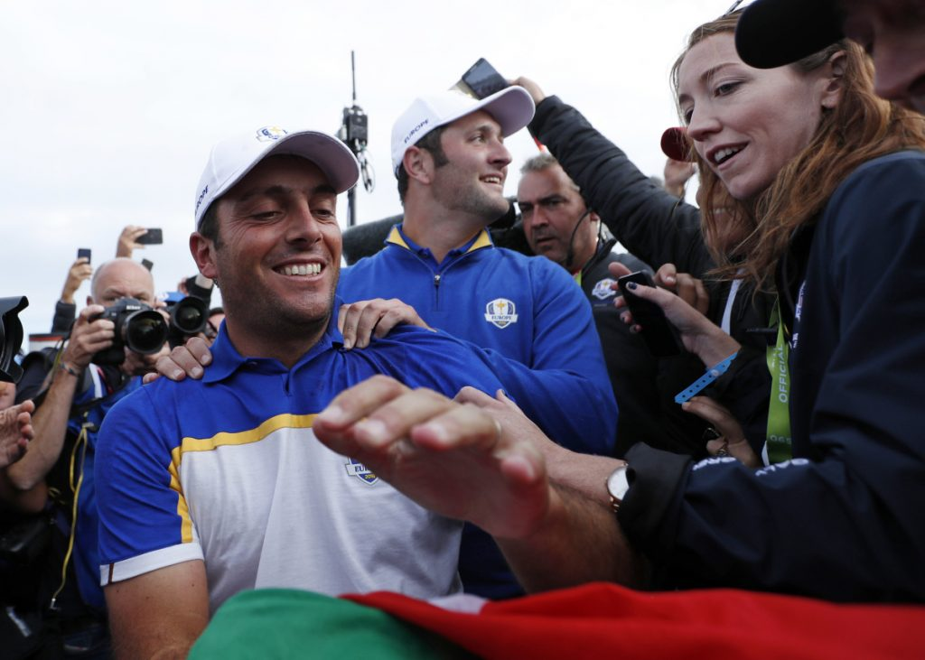 Europe's Francesco Molinari celebrates after winning his singles match to clinch the victory for Europe on the final day of the 42nd Ryder Cup at Le Golf National in Saint-Quentin-en-Yvelines, outside Paris, France.