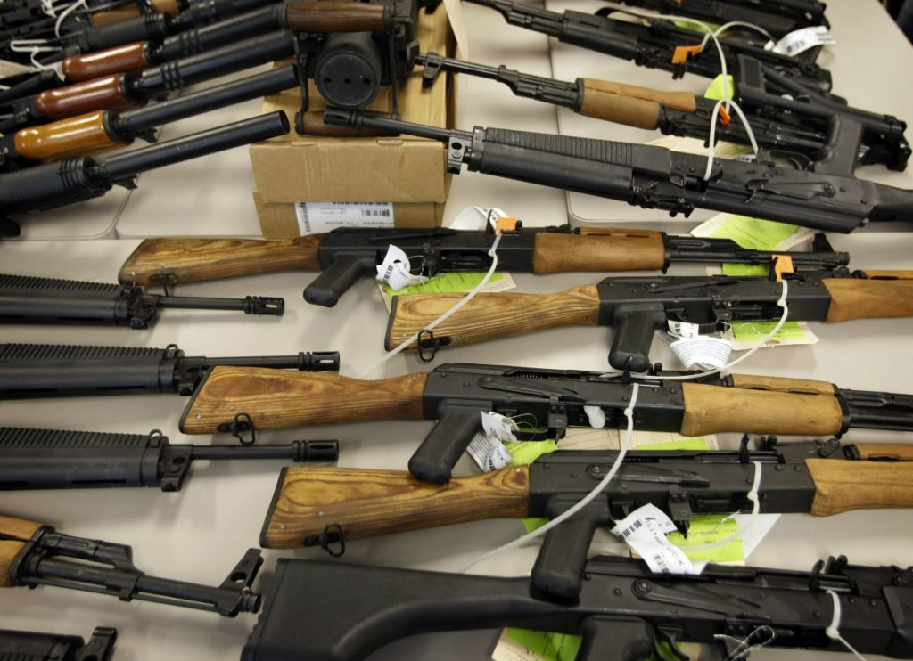 A cache of seized weapons that were to be smuggled from the United States into Mexico is displayed in Phoenix in this 2011 file photo.