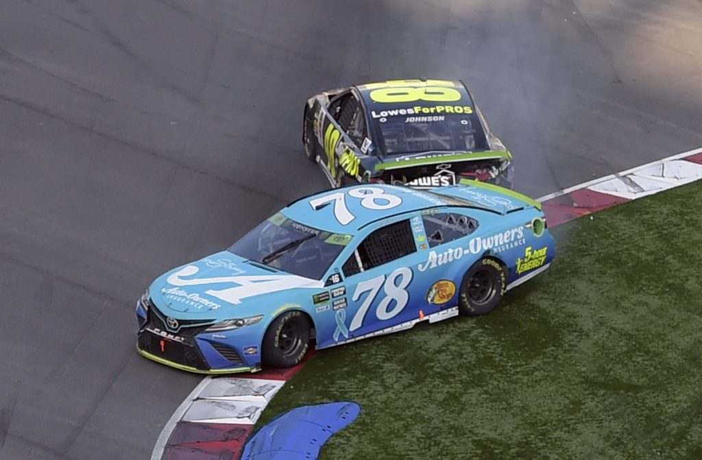 Martin Truex Jr. (78) is hit by Jimmie Johnson (48) in the last lap of the NASCAR Cup series race Sunday at Charlotte Motor Speedway in Concord, N.C.
