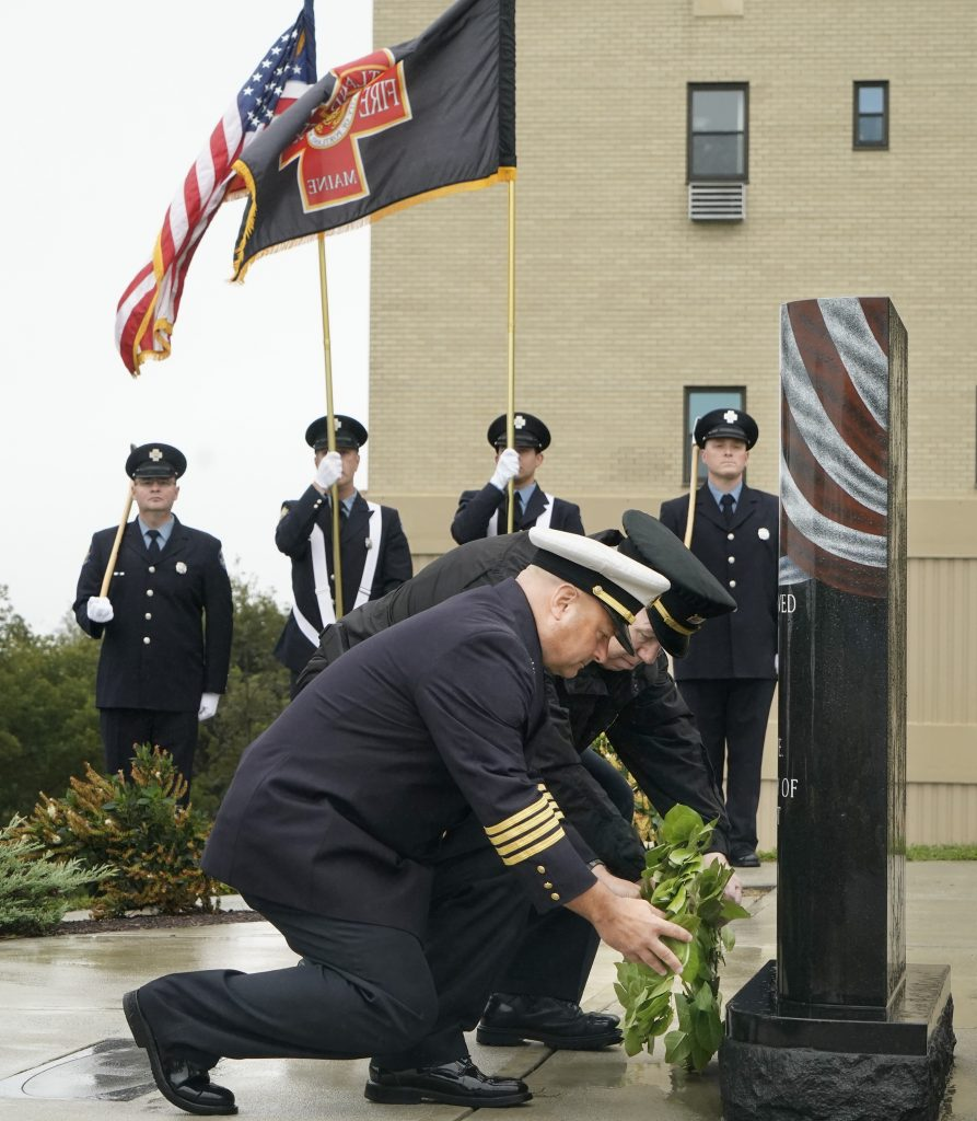 Portland Fire Chief Keith Gautreau, left, and Police Chief Vern Malloch lay wreaths at the base of the 9/11 memorial during a remembrance ceremony Fort Allen Park in Portland on Tuesday. It has been 17 years since the terrorist attacks on New York City, the Pentagon and Flight 93 over Pennsylvania.
