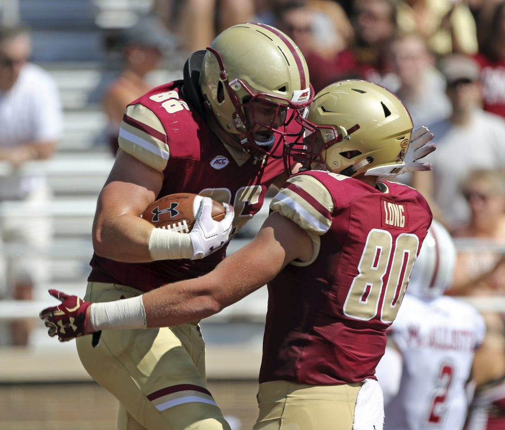 Boston College tight end Ray Marten (86) celebrates his TD with teammate Hunter Long (80) during the Eagles' 55-21 win over UMass on Saturday.