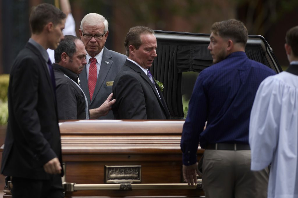 Relatives of Shanann Watts approach her casket before lifting it into a hearse outside Sacred Heart Catholic Church on Saturday in Pinehurst, N.C. A funeral Mass was celebrated for her and her daughters, Bella and Celeste, who were found dead in Colorado on Aug. 16. Chris Watts has been charged with their murders.