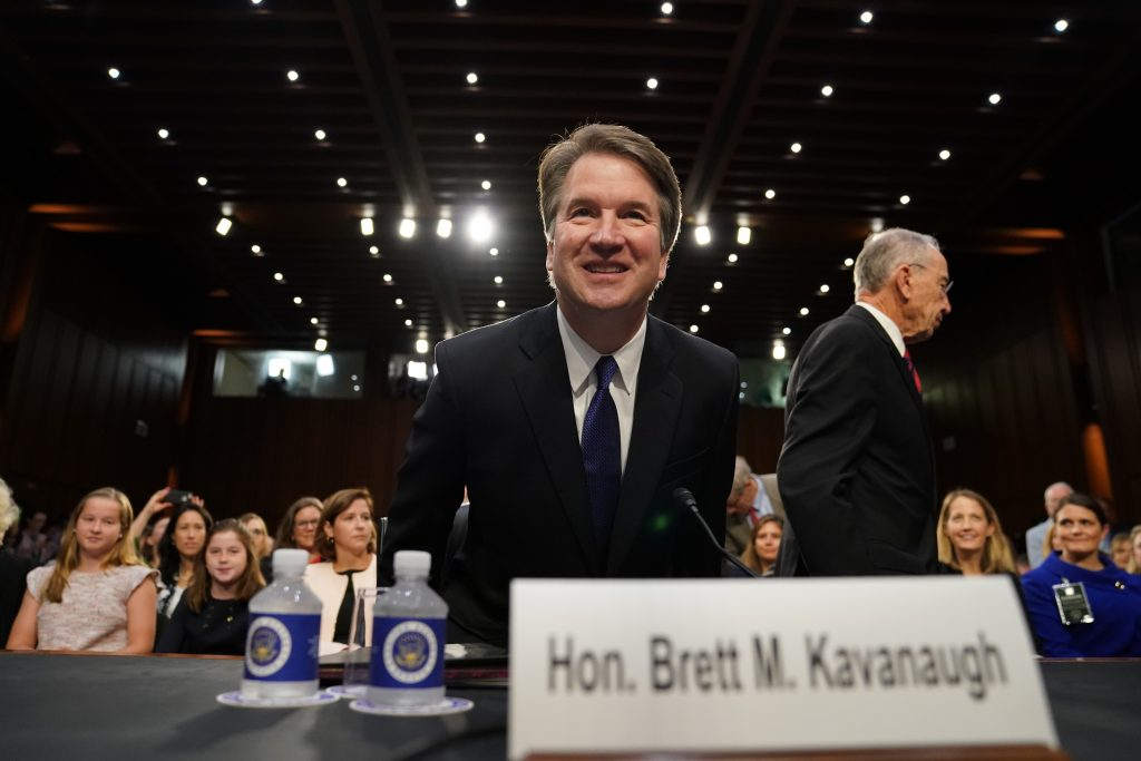 Supreme Court nominee Brett Kavanaugh arrives at the Senate Judiciary Committee on Capitol Hill on Tuesday to begin his confirmation hearing to replace retired Justice Anthony Kennedy.