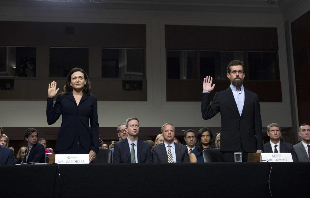 Facebook Chief Operating Officer Sheryl Sandberg  and Twitter CEO Jack Dorsey are sworn in before the Senate Intelligence Committee  on Wednesday in Washington.
